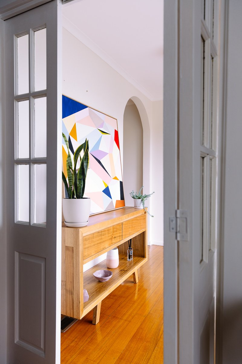 Hallway style tip: If the space allows, add a small shelf or console.