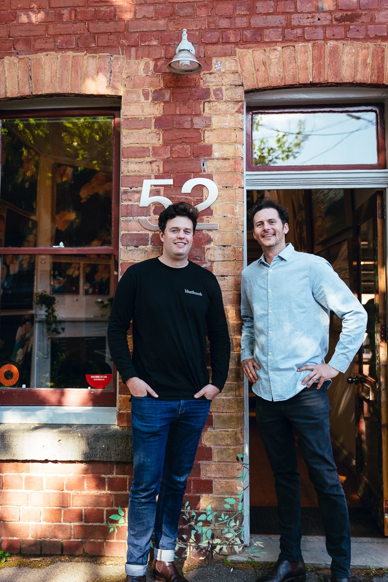 Bluethumb Co-Founders Ed & George Hartley in front of their Melbourne gallery