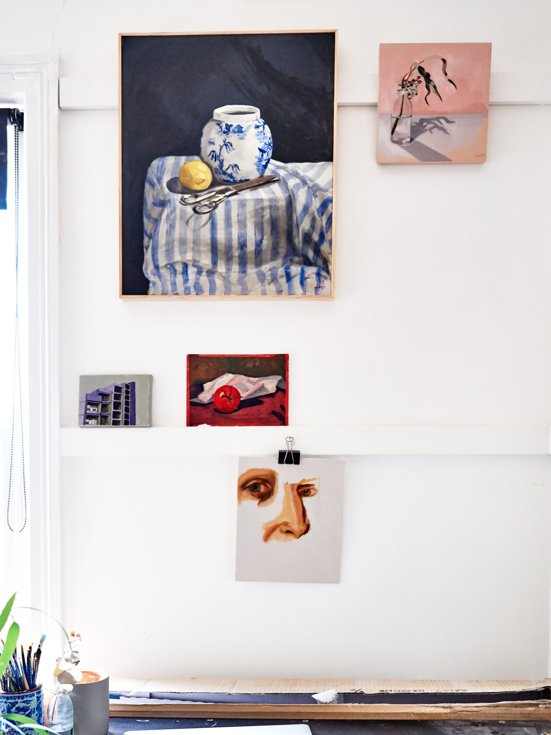 oil paint studies hanging in Sally Browne's home art studio