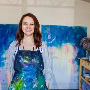 artist standing in doorway of studio